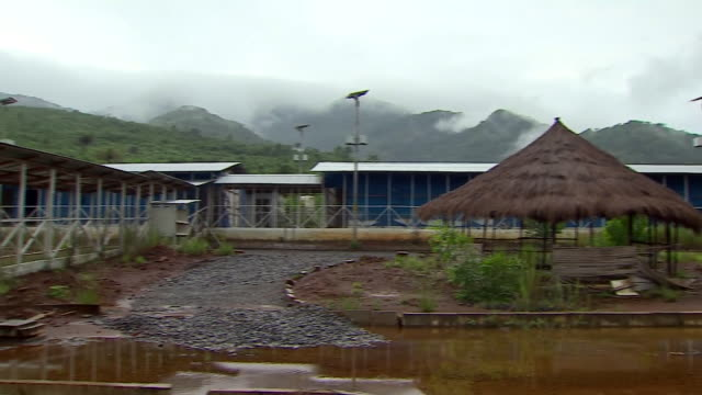 views of an ebola treatment centre in freetown, sierra leone, which has become derelict - 身体症状点の映像素材/bロール
