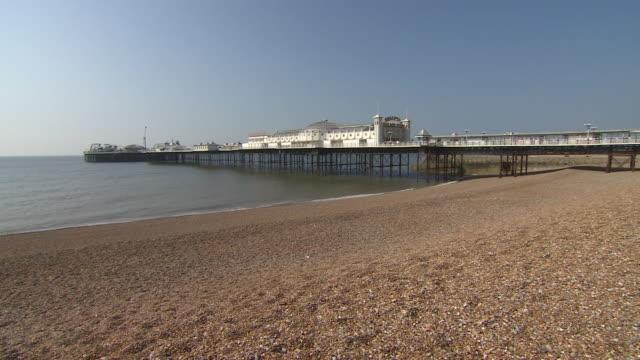 views of an empty brighton beach during the coronavirus lockdown - travel destinations stock videos & royalty-free footage