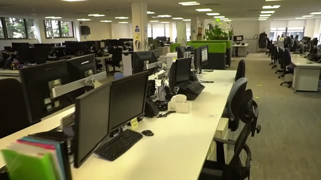 views of an empty office during the coronavirus pandemic - computer monitor stock videos & royalty-free footage