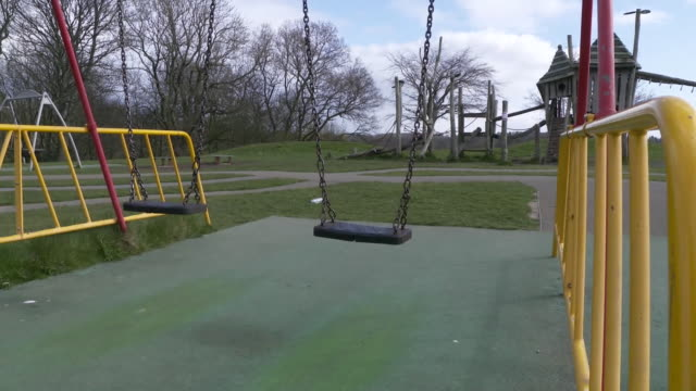 views of an empty roundhay park in leeds during the coronavirus crisis - playground stock videos & royalty-free footage