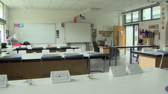 views of an empty school classroom due to coronavirus restrictions - stato di emergenza video stock e b–roll