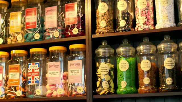 views of an old-fashioned sweet shop - sweet food stock videos & royalty-free footage