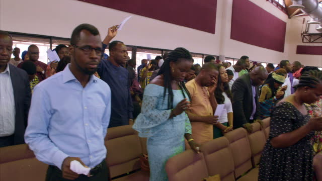 views of an rccg church service in lagos - 賛美歌点の映像素材/bロール