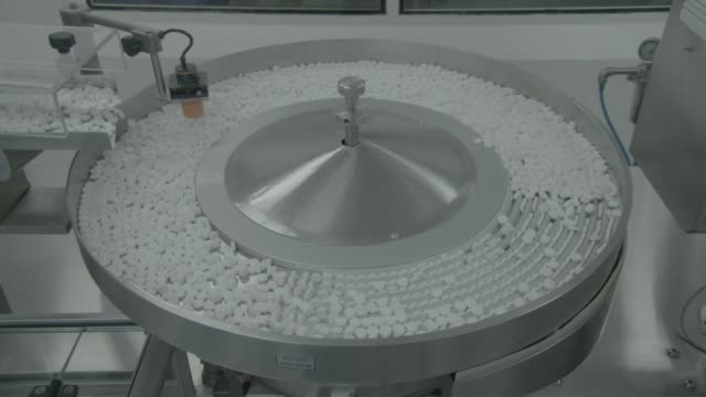 views of antibiotic pills on a production line - circle stock videos & royalty-free footage