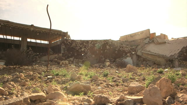 views of bab alazizia colonel gaddafi's compound now reduced to rubble after the libyan civil war - libyan civil war stock videos & royalty-free footage