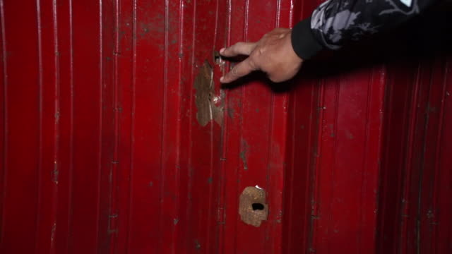 views of bullet holes in the manila suburb of pinyahan, caused by the country's drug wars - shooting a weapon stock videos & royalty-free footage