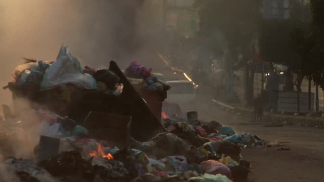 views of burning litter and a littered canal in taiz yemen - yemen stock videos and b-roll footage