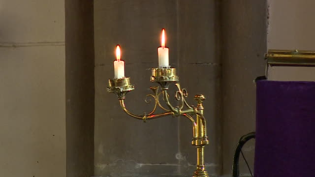Views of candles lit during a church service