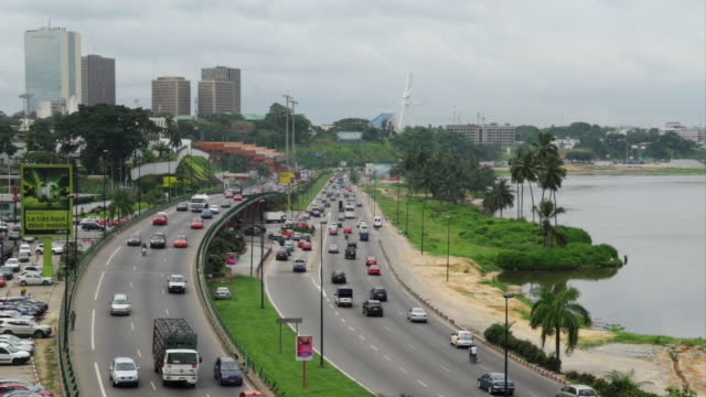 views of cars and traffic in abidjan ivory coast - côte d'ivoire stock videos & royalty-free footage