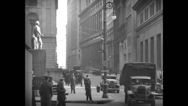 views of crowded wall street including federal hall trinity church - 1920 1929 stock videos & royalty-free footage