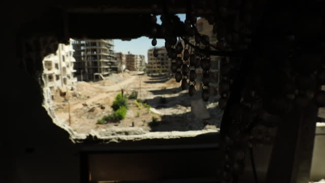 views of destroyed houses in douma, syria - rubble stock videos & royalty-free footage