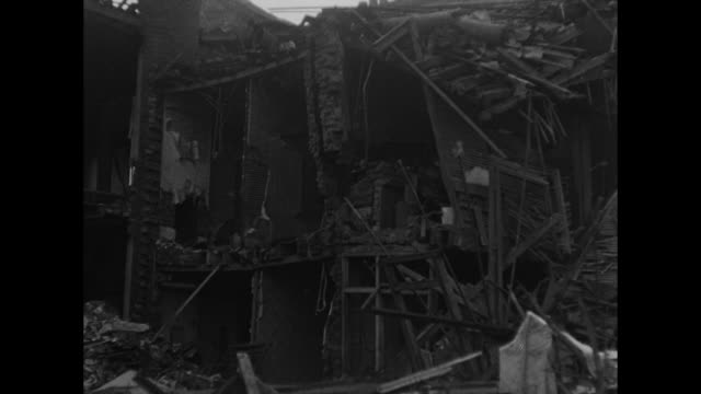 vs views of destroyed school building rescue personnel and a classroom after german air raid during world war i / note film has nitrate deterioration - petworth stock videos and b-roll footage