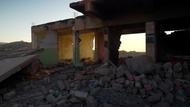 views of destruction graffiti and abandoned homes in sinjar after yazidis fled persecution by islamic state extremists - sinjar stock videos & royalty-free footage