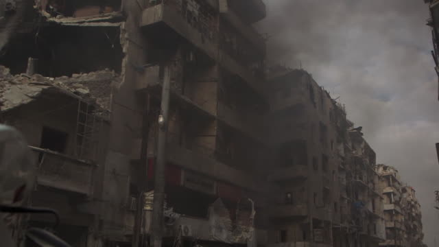 views of destruction on the streets of aleppo syria - syrien stock-videos und b-roll-filmmaterial