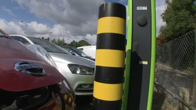 vídeos de stock, filmes e b-roll de views of electric vehicle charging points most of which are being occupied by nonelectric vehicles at stanmore tube station in northwest london... - posto de carregamento de veículos elétricos