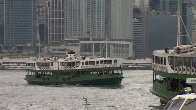 Views of ferries crossing Victoria Harbour in Hong Kong