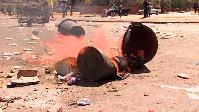 views of fires at an antigovernment corruption protest in harare zimbabwe - harare stock videos and b-roll footage