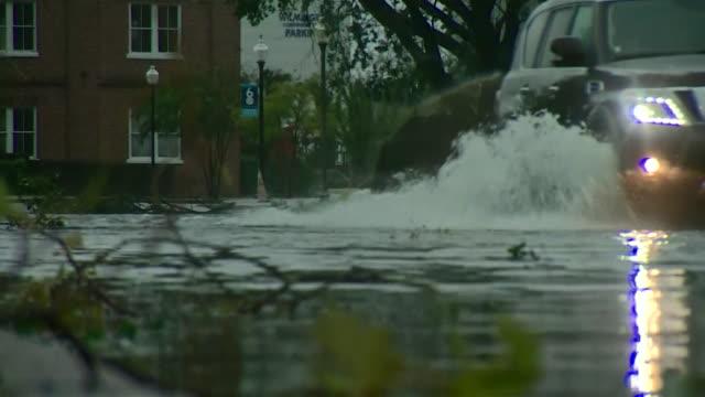 vídeos y material grabado en eventos de stock de views of flooded streets and felled trees in north carolina caused by hurricane florence - carolina del sur