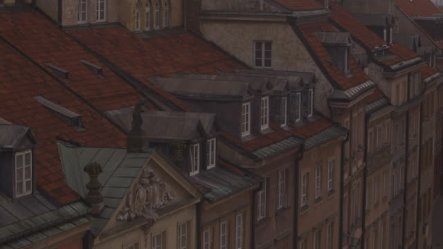 views of gabled townhouses and the rooftop of a church from warsaw's reconstructed old town market place at dusk, poland. - warsaw stock videos & royalty-free footage