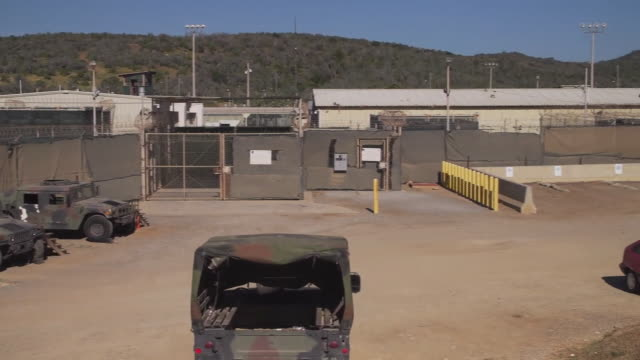 views of guantanamo bay prison and security fences - camp x ray stock videos & royalty-free footage