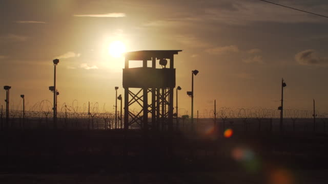 views of guantanamo bay prison at sunset - camp x ray stock videos & royalty-free footage