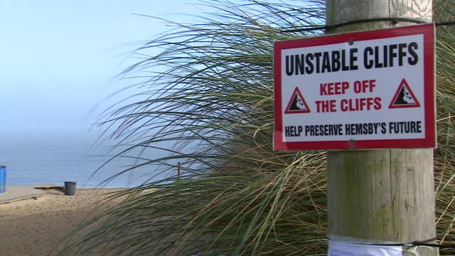 views of hemsby beach - warning sign stock videos & royalty-free footage