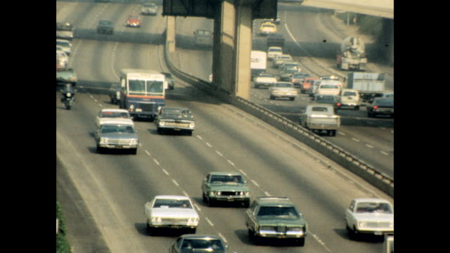/ views of highways systems cars smog and buildings in los angeles los angeles freeways and traffic on january 01 1970 in los angeles california - 1970 stock videos & royalty-free footage