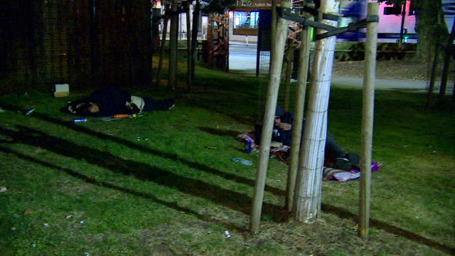 views of homeless people sleeping rough in a london park - bedclothes stock videos & royalty-free footage