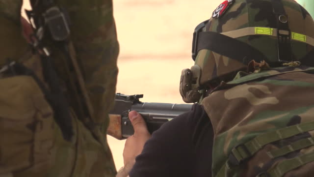 views of iraqi government soldiers undergoing training as they prepare to tackle islamic state - 迷彩柄点の映像素材/bロール