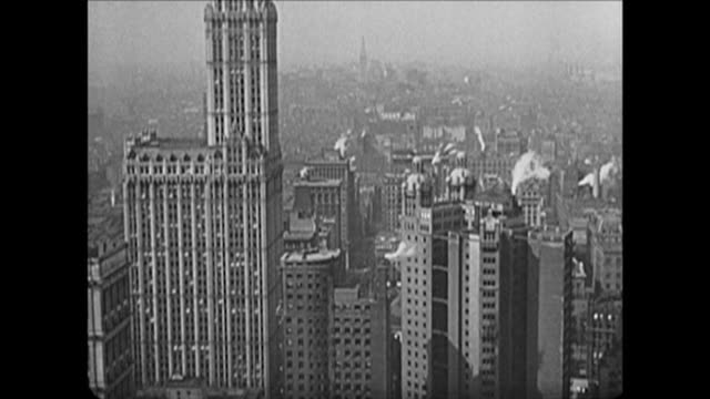 1921 views of lower manhattan, tilt down woolworth building - 1921 stock videos & royalty-free footage