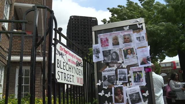views of missing posters and residents near the grenfell tower - missing persons stock videos & royalty-free footage