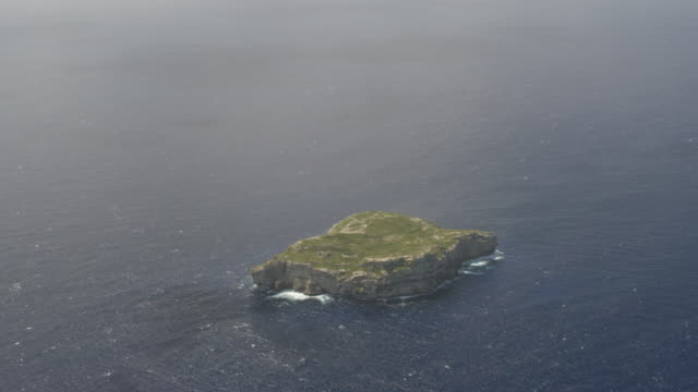 WS TD AERIAL POV Views of Monito Island sitting in middle of Caribbean Sea / Monito Island, Puerto Rico, United States