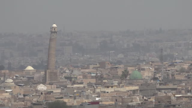 vídeos de stock, filmes e b-roll de views of mosul and the great mosque of alnuri where islamic state leader abu bakr albaghdadi made his first appearance - iraque