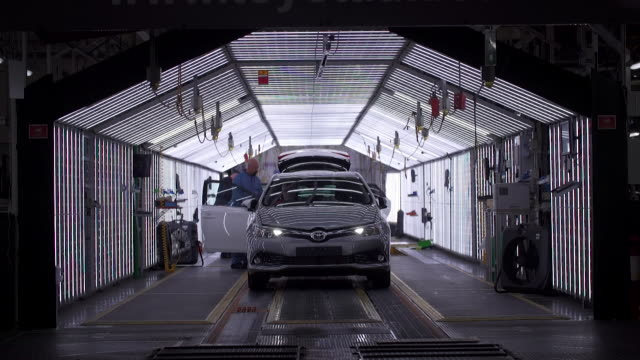 views of new cars being driven off a production line - production line stock videos & royalty-free footage