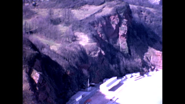 views of oddicombe beach in devon prior to the erosion of the cliff and collapse of houses. elevated view of coast / pan left to right / limestone -... - 堆積岩点の映像素材/bロール