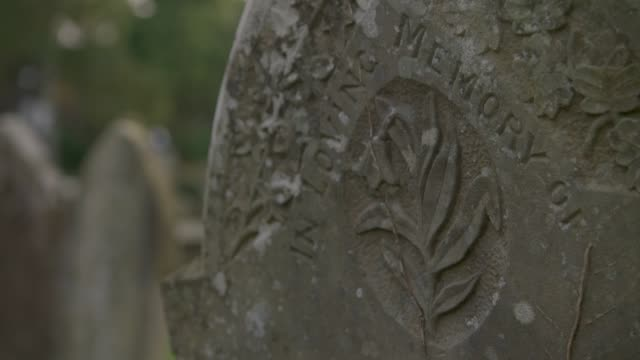 Views of old tombstones in a churchyard