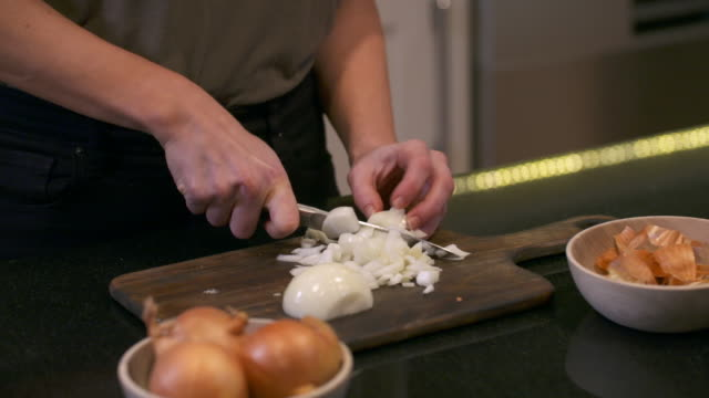 cu views of onions being chopped and fried - cooking stock videos & royalty-free footage