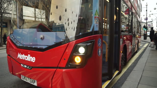 views of passengers getting on and off a double-decker bus in london - double decker bus stock videos & royalty-free footage