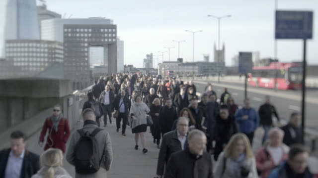 views of pedestrians walking across london bridge - pedestrian stock videos & royalty-free footage