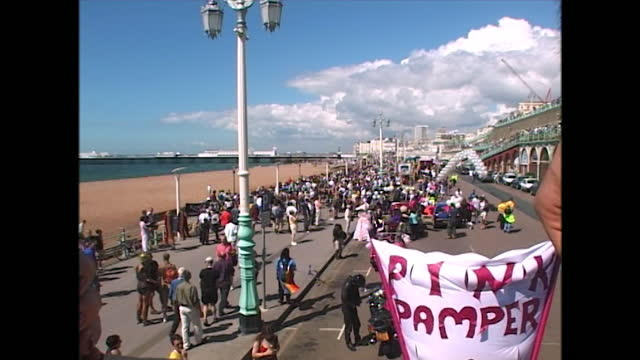 views of people and floats taking part in pride along the seafront in brighton, uk; 2000. - wide shot stock videos & royalty-free footage