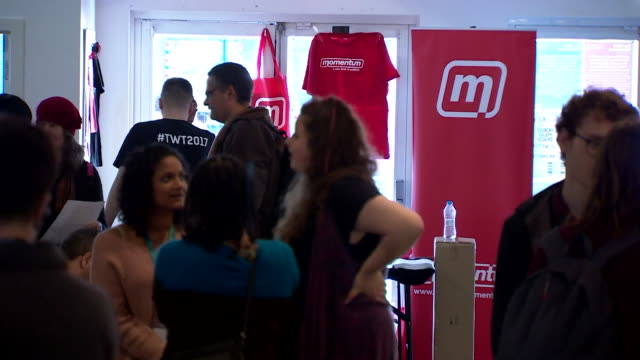 views of people bustling around and momentum merchandise on sale at the labour party conference in brighton september 2017 nnby326h absa627d - 労働党点の映像素材/bロール