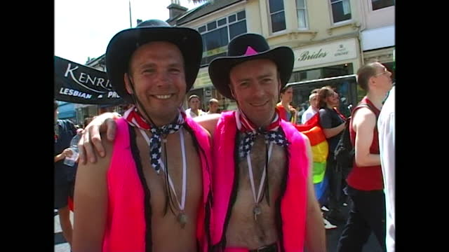 views of people in drag and fancy dress at a pride event in brighton, uk including two people in matching pink waistcoats, hats and stars and stripes... - bright stock videos & royalty-free footage