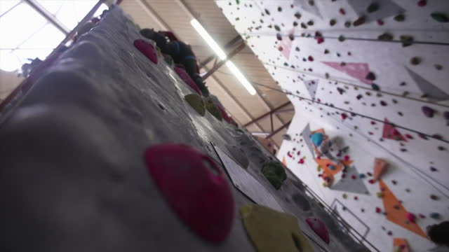 views of people on a climbing wall - rock climbing stock videos & royalty-free footage
