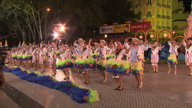 Views of people performing as part of traditional Feast of St Anthony celebrations Lisbon Portugal FKIY886P ABRA690X