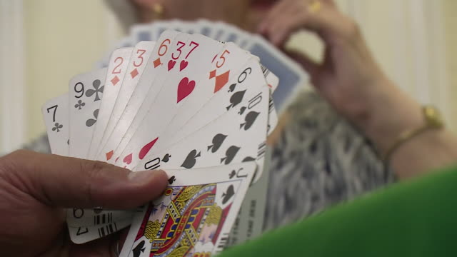 views of people playing bridge - carte da gioco video stock e b–roll