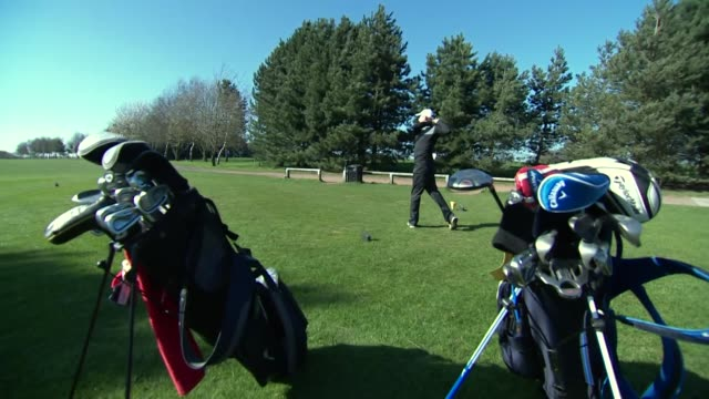 views of people playing golf - golf swing stock videos & royalty-free footage