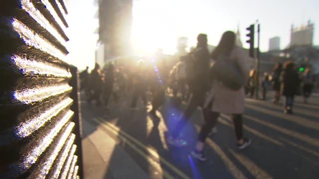 views of people walking across westminster bridge - pavement stock videos & royalty-free footage