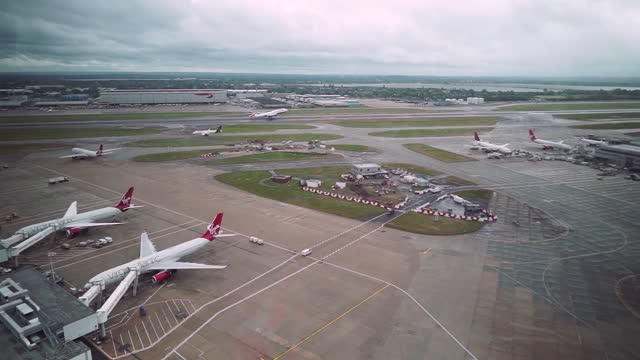 views of planes on runways at heathrow airport - moving down stock videos & royalty-free footage