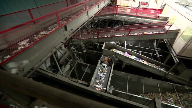 views of plastic waste moving along conveyor belts at a recycling plant - recycling stock videos and b-roll footage