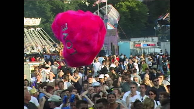 views of pride at preston park in brighton in 2000, including a large heart-shaped prop filled with balloons reading 'love' being passed from person... - love emotion stock videos & royalty-free footage